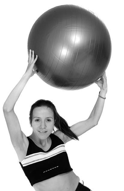 woman holding yoga ball