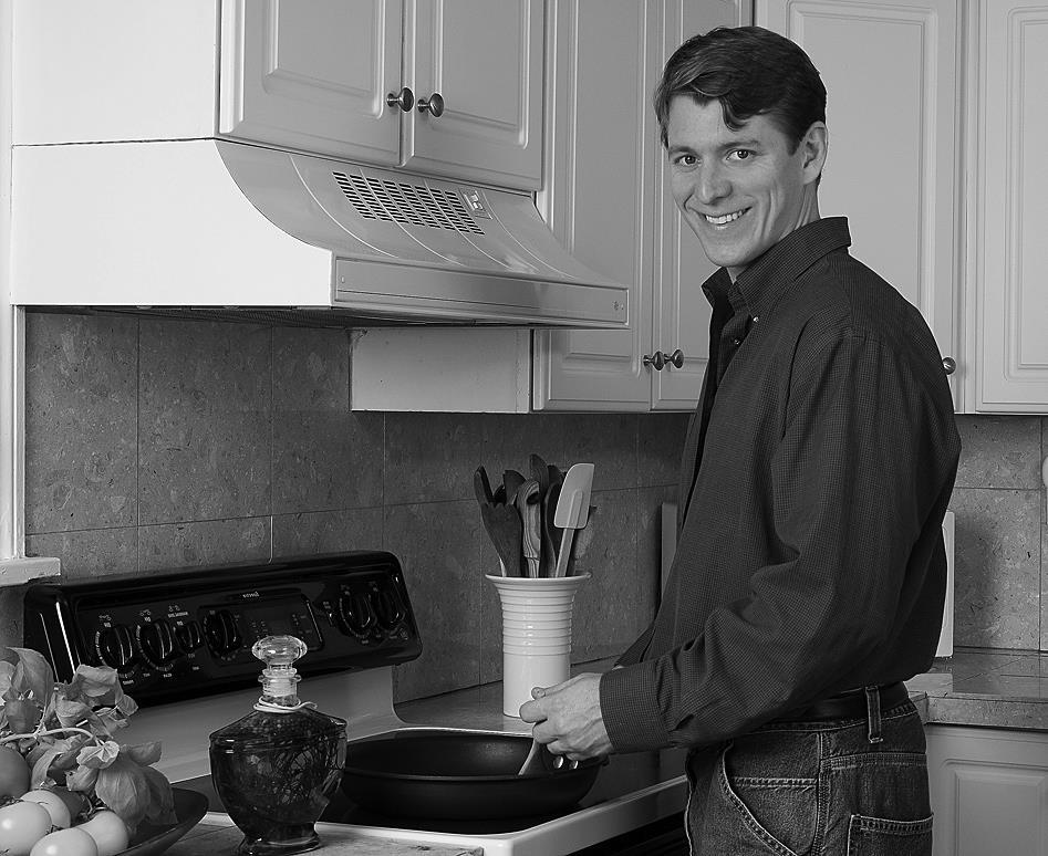 man cooking at stove