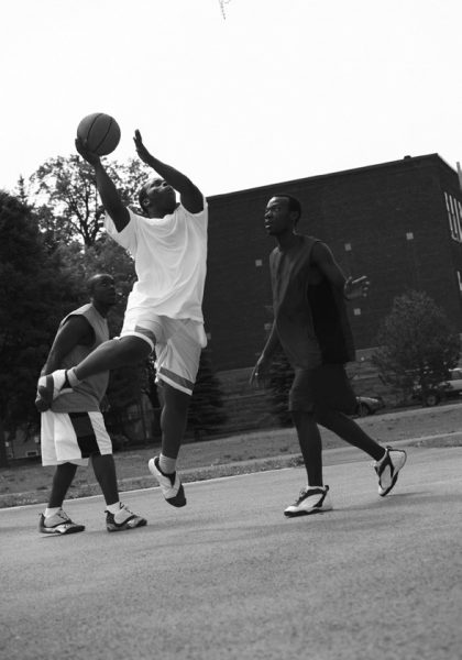 3 men playing basketball