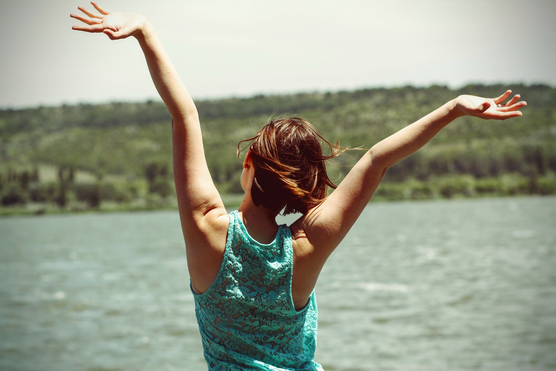 woman with arms in the air