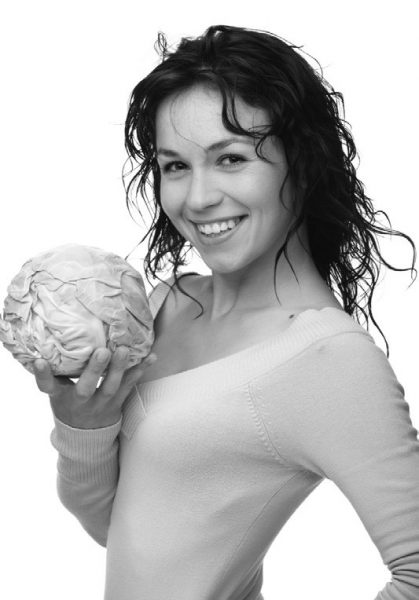 woman holding cabbage