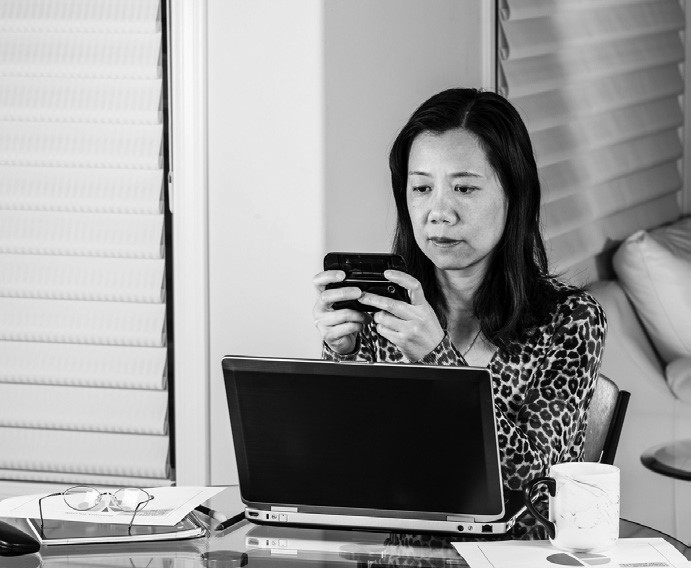 woman with computer and phone