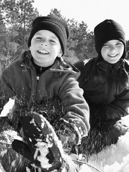 2 kids playing in snow