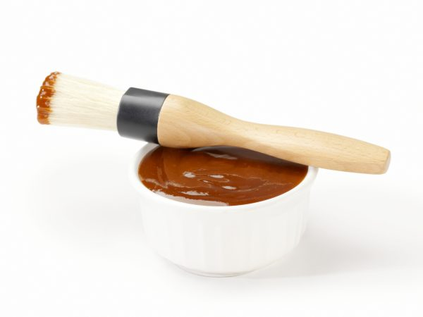 BBQ sauce in bowl with brush