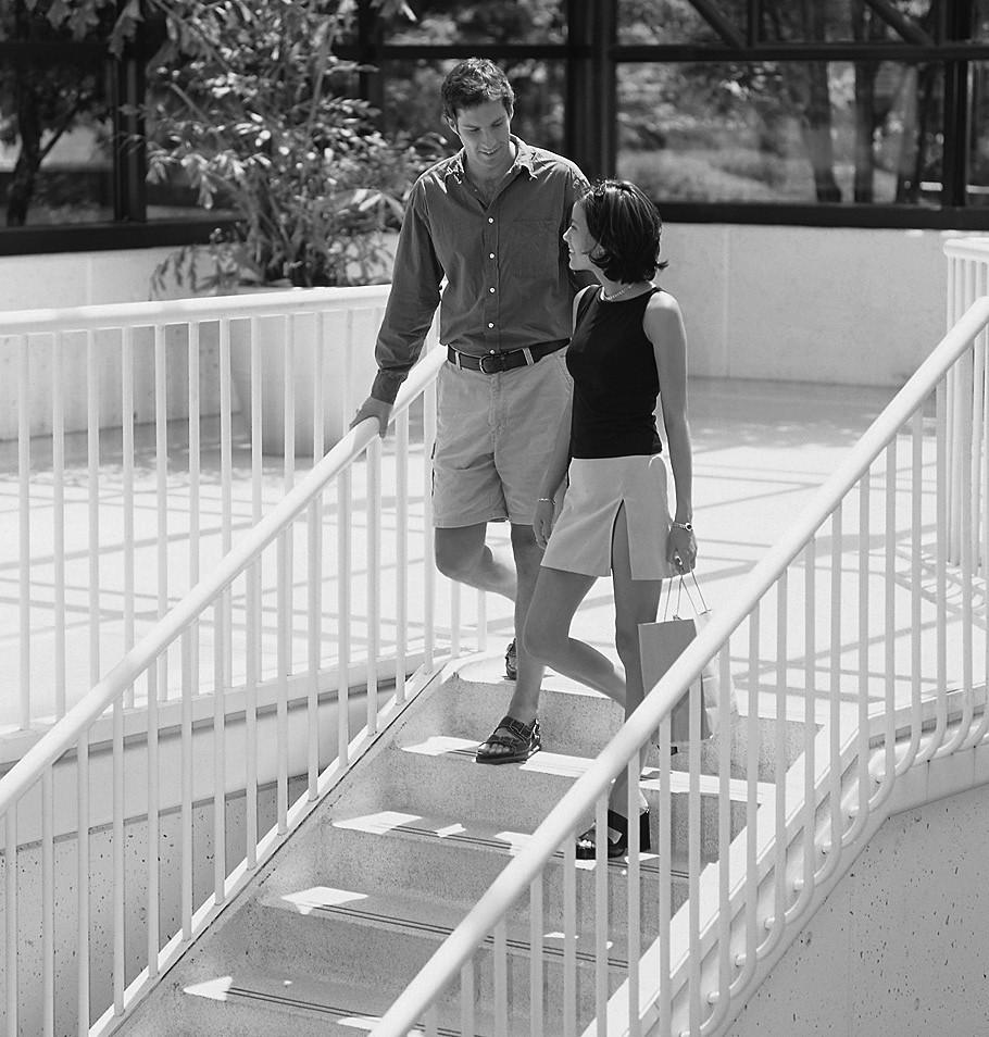 man and woman walking down steps