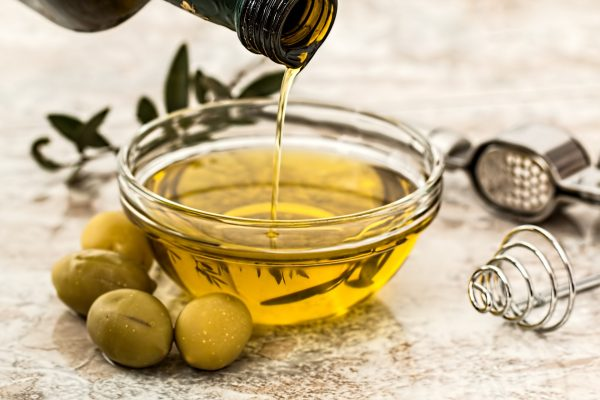 olive oil pouring into a bowl
